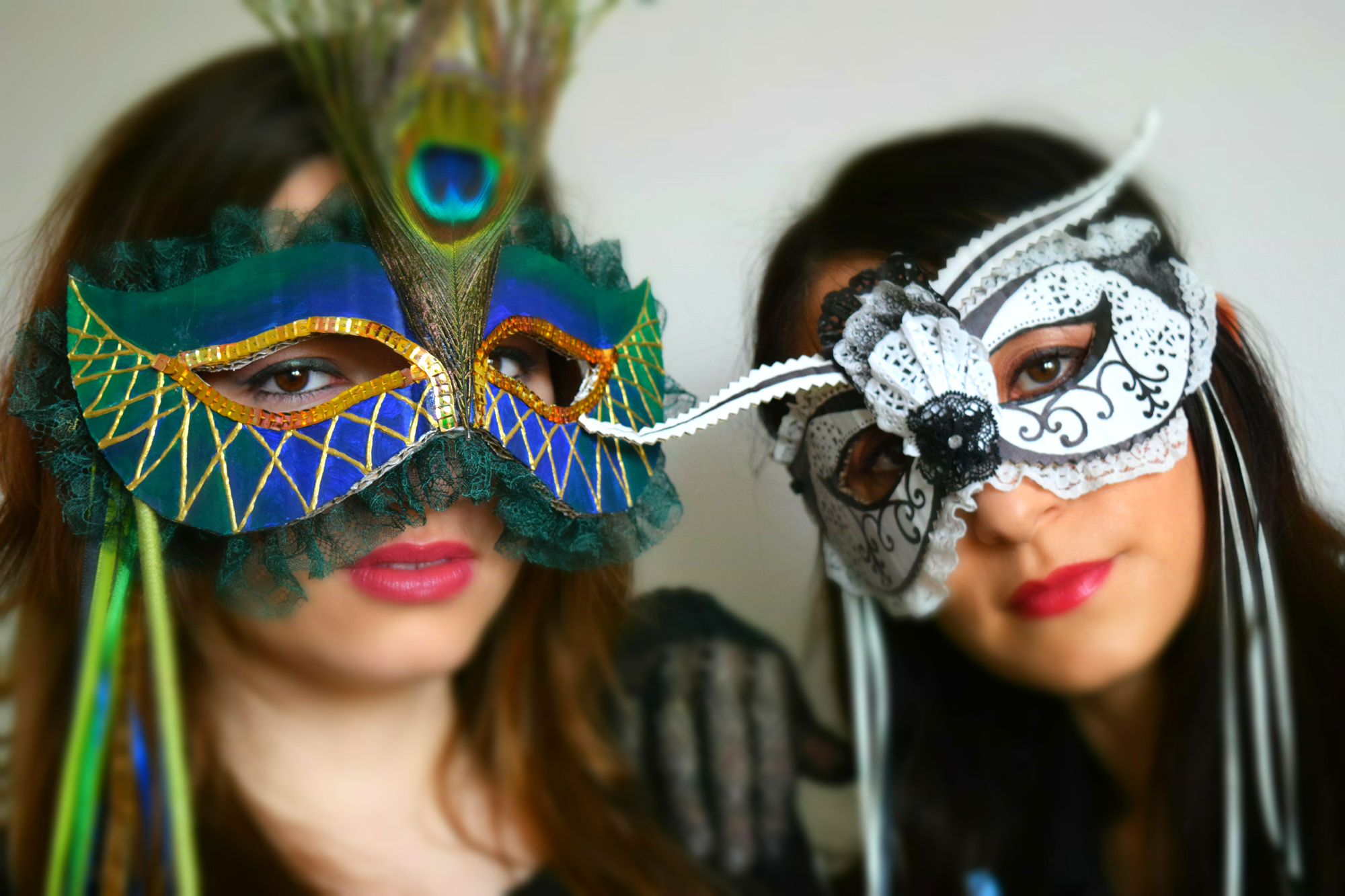Giulia with Peacock mask and Ilaria with the Black & White mask