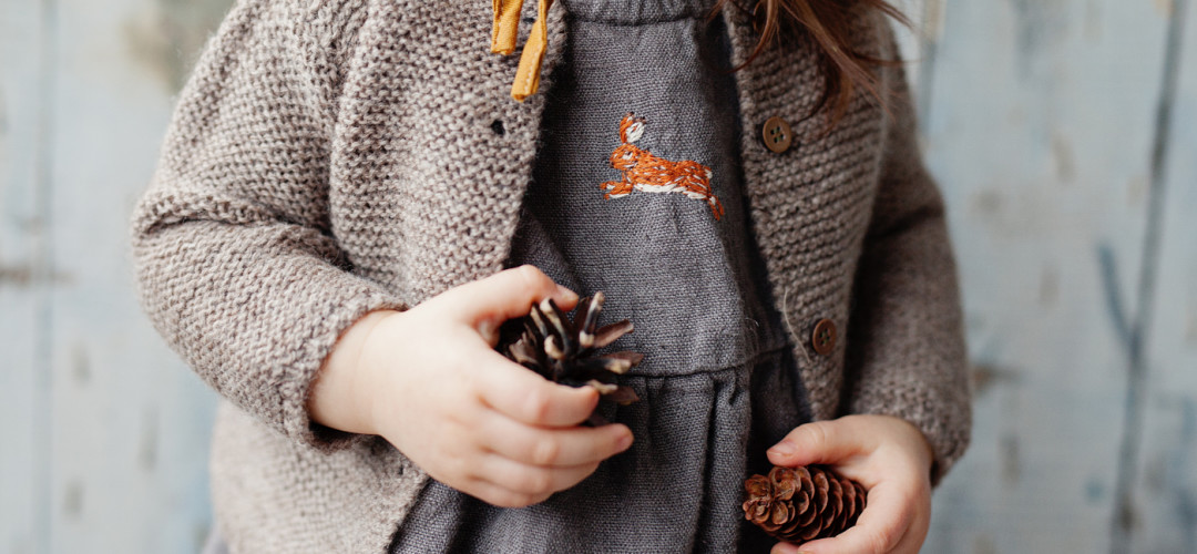 Handmade linen romper with hare embroidery by La Petite Alice.