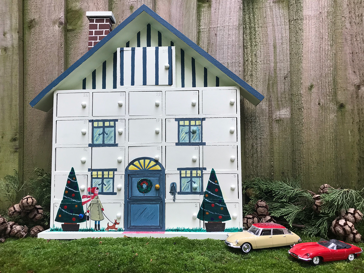 My painted wooden advent house calendar