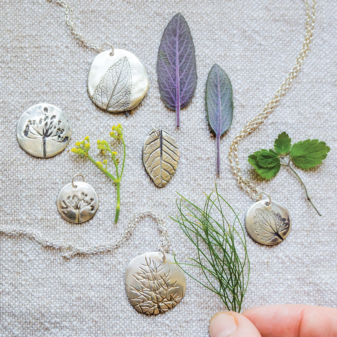 Silver Fossil Pendants from 'Making Winter' by Emma Mitchell.